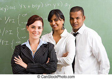 confident maths teachers - teachers in front of blackboard
