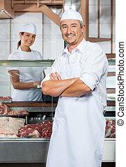 Confident Mature Male Butcher In Shop