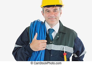 Confident mature man with rolled wire