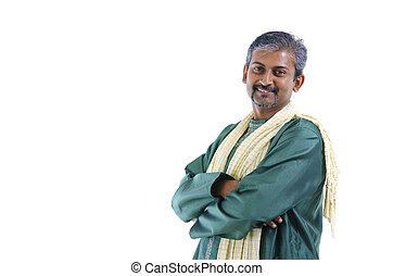 Confident mature traditional Indian man in kurta dhoti...