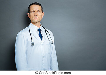Confident medical professional looking into camera