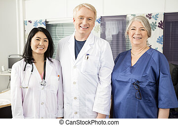 Confident Medical Team Smiling Together In Clinic