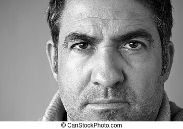 Confident middle aged man looks at the camera - Confident...