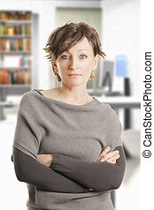 Confident middle aged woman in gray