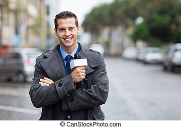 confident news reporter outdoors in the rain