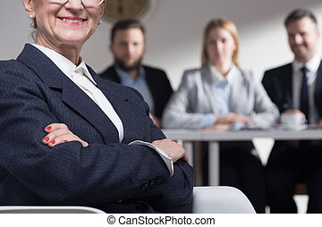 Confident older woman in suit and job interview