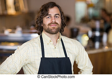 Confident Owner Standing In Espresso Bar