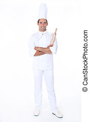Confident pastry cook on white background