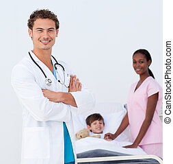 Confident pediatrician and nurse attending to a child