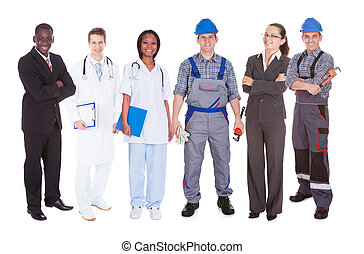 Full length of confident people with diverse occupations standing against white background
