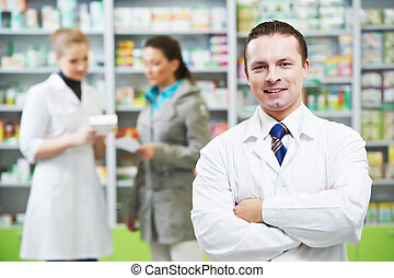 Confident pharmacy chemist man in drugstore - cheerful ...