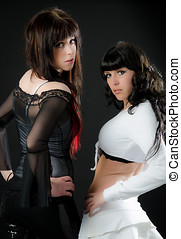 Confident pose from two sexy young girls