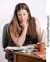Confident Pregnant Young Woman Paying Bills