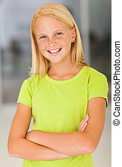 confident preteen girl portrait with arms crossed
