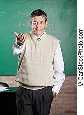 Confident Professor Gesturing In Classroom - Portrait of ...
