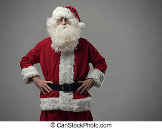 Confident proud santa posing with arms akimbo and looking at camera, Christmas and holidays concept