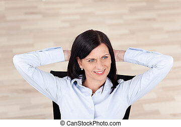 Confident relaxed businesswoman