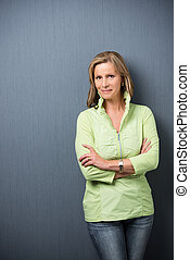 Confident relaxed middle-aged woman