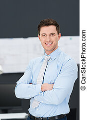 Confident relaxed young businessman