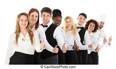 Confident Restaurant Staff Gesturing Thumbs Up