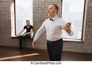 Confident retired man performing in the dance studio