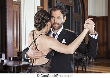 Confident Romantic Man Performing Tango With Woman