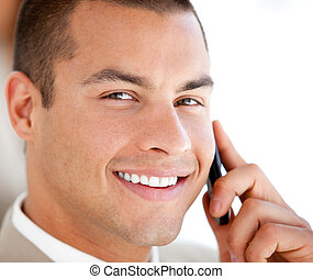 Confident salesman at phone in his office