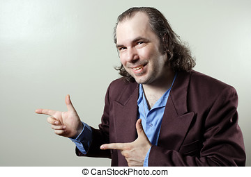 Confident salesman pointing - Photo of a sleazy salesman...