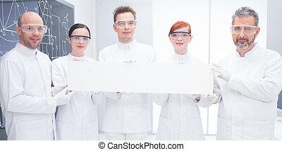 confident scientists in lab