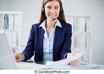 Confident secretary - Portrait of a smiling secretary...