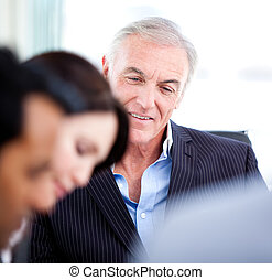 Confident senior businessman in a meeting