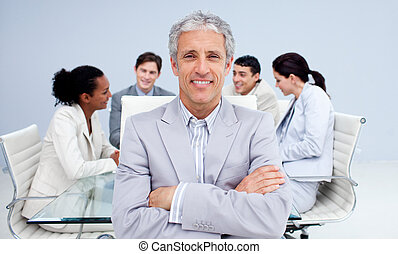 Confident senior businessman smiling in a meeting