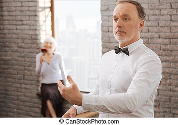 Confident senior man performing in the dance studio