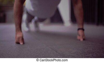 Confident senior sporty man doing push ups