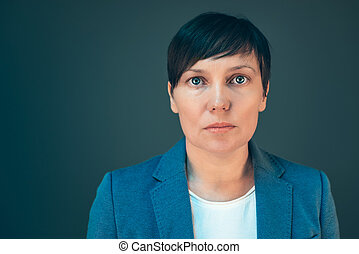 Confident serious business woman portrait with copy space