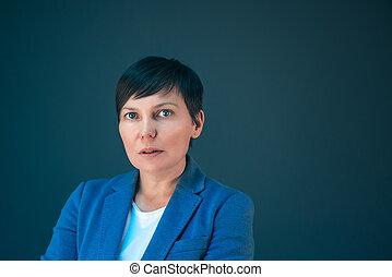 Confident serious business woman portrait with copy space