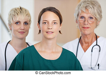 Confident Serious Medical Team Of Doctors In Clinic