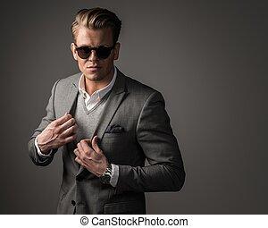 Confident sharp dressed man in black suit