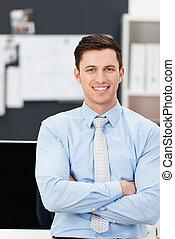 Confident sincere young businessman