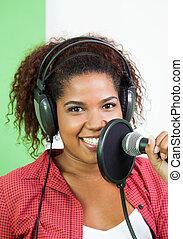 Confident Singer Performing In Recording Studio