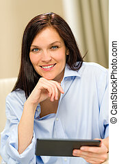Confident smiling woman with digital tablet