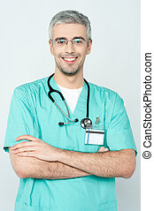 Confident smiling young doctor posing