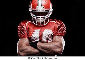 Confident sportsman folding his hands.