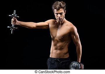 Confident sportsman training with weights