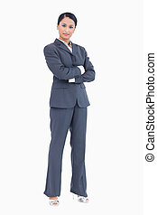 Confident standing businesswoman with arms folded
