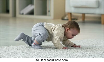 Confident Steps - Adorable child making his first confident...