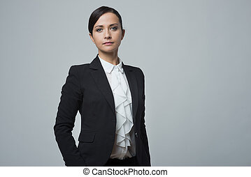 Confident strong businesswoman posing