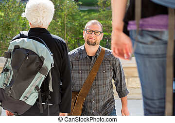 Confident Student Walking On College Campus