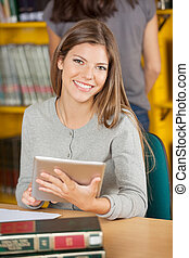 Confident Student With Digital Tablet In University Library