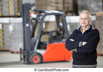 Confident Supervisor Standing At Warehouse